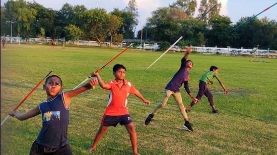 Young javelin throwers in action at Kaushambi in Uttar Pradesh on Monday. (HT Photo)