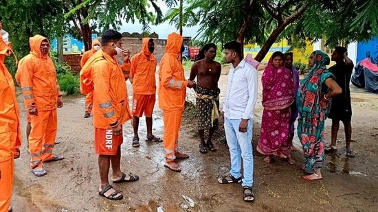 National Disaster Response Force (NDRF) personnel interact with local residents in the wake of Cyclone Gulab, in Ganjam.(ANI Photo)