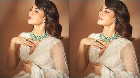 Flaunting her midriff, Jacqueline teamed the saree with a sleeveless bralette-styled blouse. The blouse had a plunging neckline, lace adorned hem, bead and pearl embroidery, and intricate threadwork.(Instagram/@chandiniw)