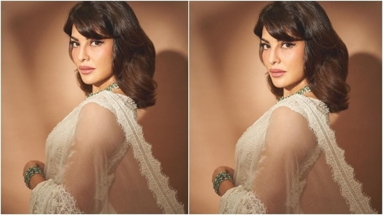 Jacqueline completed the look by donning a matching embroidered sheer white jacket on her shoulders. The hem, sleeves, and the front panel of the drape came decorated with embroidered lace that had scalloped borders. The layering added a sleek modern vibe.(Instagram/@chandiniw)