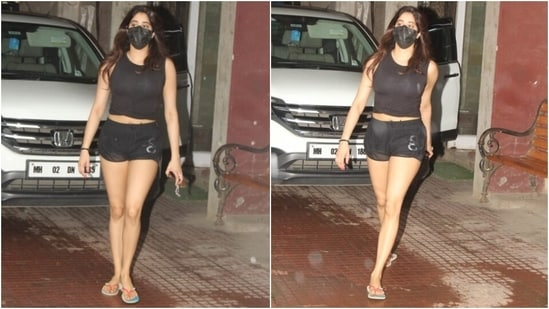 The actor teamed the cropped tank top with matching black workout shorts and showed off her svelte frame. She completed the look with a black face mask to keep herself safe during the pandemic and multi-coloured flip flops.(HT Photo/Varinder Chawla)