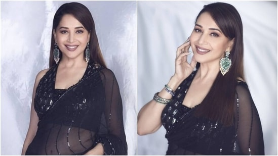 Madhuri Dixit in sheer black Manish Malhotra saree and sleeveless blouse is too glam to give a damn