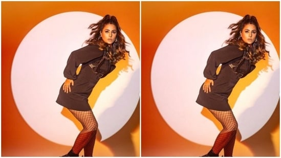 The black dress, with full sleeves, came accessorised with a leather suspender corset belt, designed by Leather Subculture. The balloon sleeves and slip-like silhouette perfectly accentuated her frame as she posed like a diva.(Instagram/@realhinakhan)