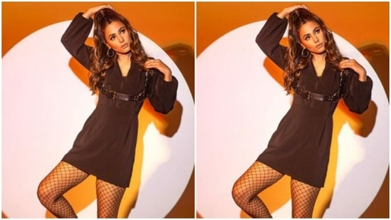 She opted for ankle-length classic black boots and teamed them with fishnet stockings to give a glam aura to her overall attire.(Instagram/@realhinakhan)