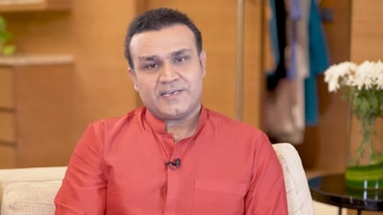 Virender Sehwag ( in frame) 'can't understand' why Chahal is not in India's T20 World Cup squad