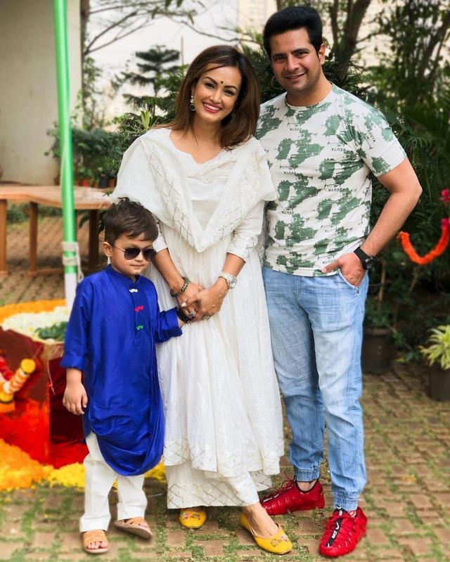 In happier times with wife Nisha Rawal and son Kavish.