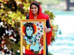 A Muslim woman from Kerela dedicated her Lord Krishna painting in a Hindu temple.(Instagram/@_jasna_salim)