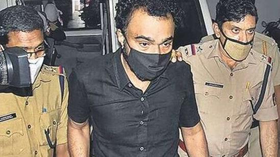 Monson Mavunkal in police custody on Tuesday. PTI