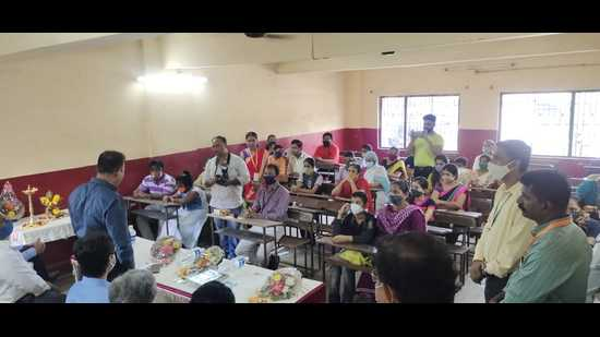 Members of the Soham Foundation in Ulhasnagar with the students and their family members seeking financial aid for their education recently. Fifty eight students, who lost one parent or both parents to Covid were finalised. (HT PHOTO)