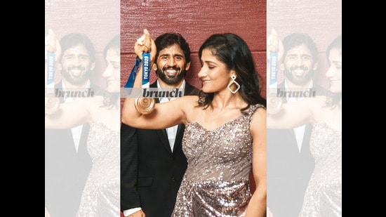 Sangeeta, 23, and Bajrang, 27, married in November 2020. But they have pretty much been kept apart since then, first because Bajrang was training hard for the Olympics, and then because of the felicitation ceremonies he has had to attend since returning from Tokyo with an Olympic medal; Styling: Avneet Chadha; Art direction: Amit Malik; Assistant styling: Tanya Aggarwal; Make-up and hair: Artistry by Anjali Jain; Location courtesy: Hilton Garden Inn New Delhi/Saket; On Bajrang: Pants & blazer: Raymonds; Shirt: Park Avenue; Shoes: Bata; On Sangeeta: Gown: Dolly J; Earrings: Soni sapphire; Heels: Bata (Hari Nair)