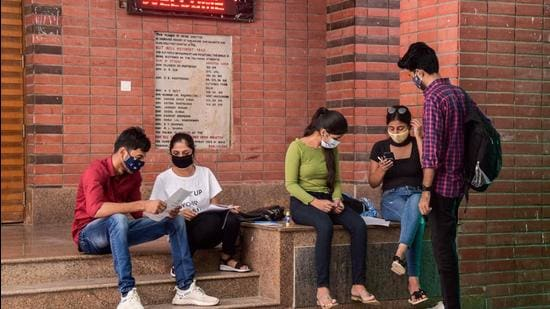 tudents inside Ramjas College. The Delhi University announced its first cut-off list for admissions to undergraduate courses on Friday. Many colleges have announced 100% cut-off for honours in popular subjects such as English, Economics. (PTI Photo)