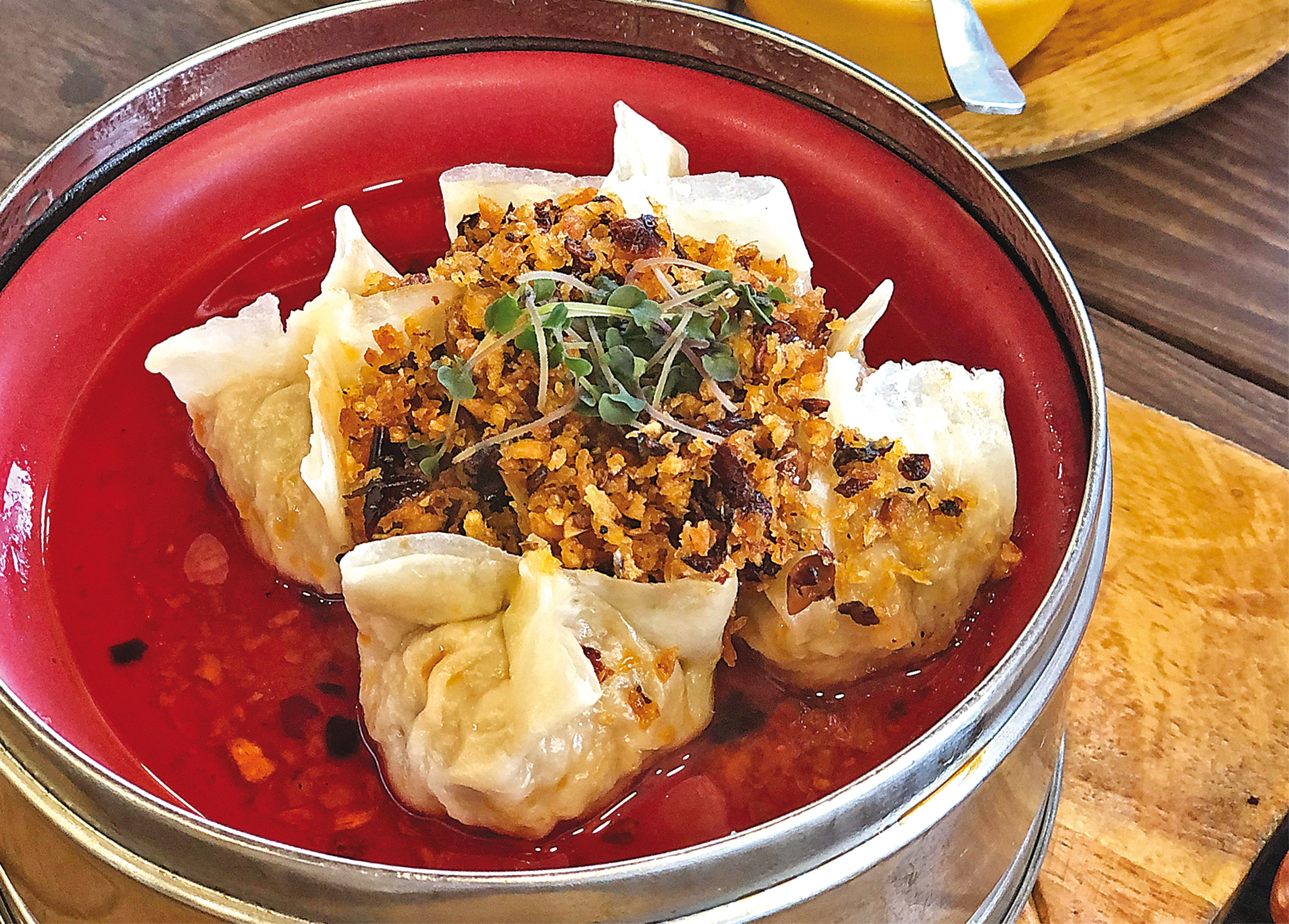 A favorite (non-authentic) dim sum is a dumpling in a light red sauce topped with crispy fried garlic