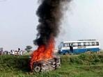 A vehicle set ablaze in Lakhimpur Kheri on Sunday.(ANI)