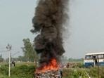 Vehicles set ablaze after violence broke out in Lakhimpur Kheri on Sunday.(PTI)