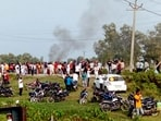 A vehicle set ablaze after violence broke out after farmers agitating were allegedly run over by a vehicle in the convoy of a union minister, in Lakhimpur Kheri.(PTI)