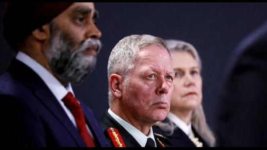 Canada's minister of national defence Harjit Sajjan (left) faces a tough battle holding on to his prime portfolio in the new Justin Trudeau cabinet over controversies around his former Chief of Defence Staff Canada's General Jonathan Vance (centre) (REUTERS/File photo)