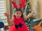 Inaaya Naumi Kemmu enjoying Christmas in her cute red dress and reindeer hairband.