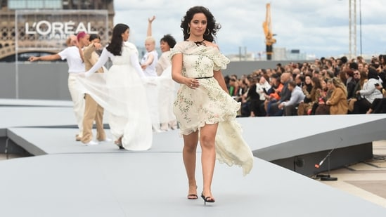 Cuban-US singer-songwriter Camila Cabello walks the ramp at the ongoing Paris Fashion Week showcasing L'Oreal Paris 2021 Womenswear Spring/Summer 2022 collection at the Trocadero.(AFP)