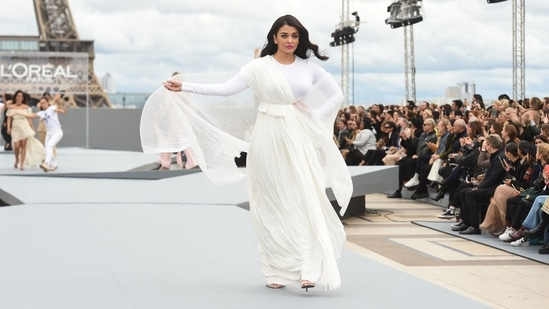 Many international names, including actor Aishwarya Rai Bachchan, walked the ramp at the Trocadero, in Paris, for L'Oreal. She wore a creation from their Spring-Summer 2022 Ready-to-Wear collection and was truly a vision to behold.(AFP)