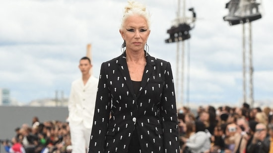 British actress Helen Mirren also walked the ramp for L'Oreal during the Paris Fashion Week. She wore a creation from the brand's Spring-Summer 2022 Ready-to-Wear collection. Serving boss lady vibes, the actor wore an embellished black power suit and styled it with OTT eye make-up, sleek bun and statement-making heels.(AFP)