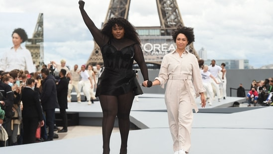 French singer/songwriter Yseult (L) presents a creation for L'Oreal at the Paris Fashion Week.(AFP)