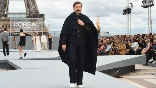 Game Of Thrones fame actor Nikolaj Coster-Waldau presents a creation for L'Oreal on the sidelines of the Paris Fashion Week Spring-Summer 2022 Ready-to-Wear collection shows at the Trocadero, in Paris.(AFP)