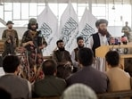 Afghanistan Taliban officials attend a news conference where they announced they will start issuing passports to its citizens again.(Reuters)