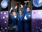 Russian cosmonaut Anton Shkaplerov, film director Klim Shipenko and actress Yulia Peresild wave as they leave to board the spacecraft.(via Reuters)