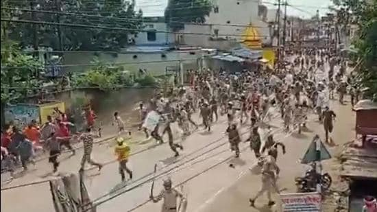 The Chhattisgarh police imposed curfew in Kawardha town of Kabirdham district after violence broke out over flags put up by people from two communities. Police use cane charge to disperse the groups of people who had gathered. (Twitter/ChhattisgarhBJP)
