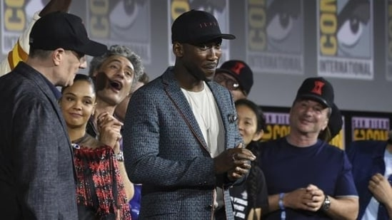 Mahershala Ali, centre, wears a hat to promote his new movie Blade at the Marvel Studios panel on day three of Comic-Con International on July 20, 2019, in San Diego.(Chris Pizzello/Invision/AP)