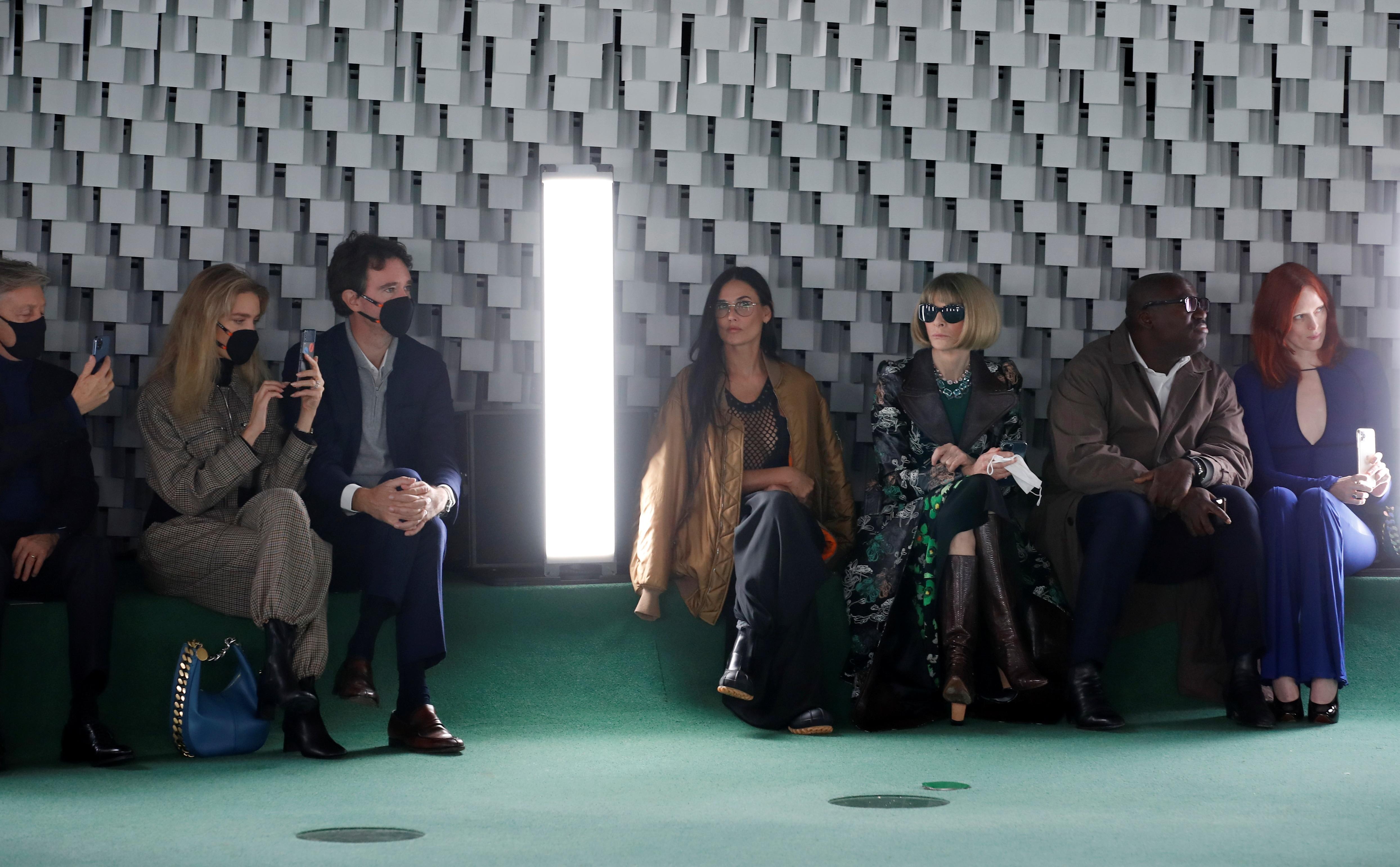 Sir Paul McCartney, Antoine Arnault and his wife Natalia Vodianova, Demi Moore, Edward Enninful and Karen Elson attend Stella McCartney show(REUTERS)