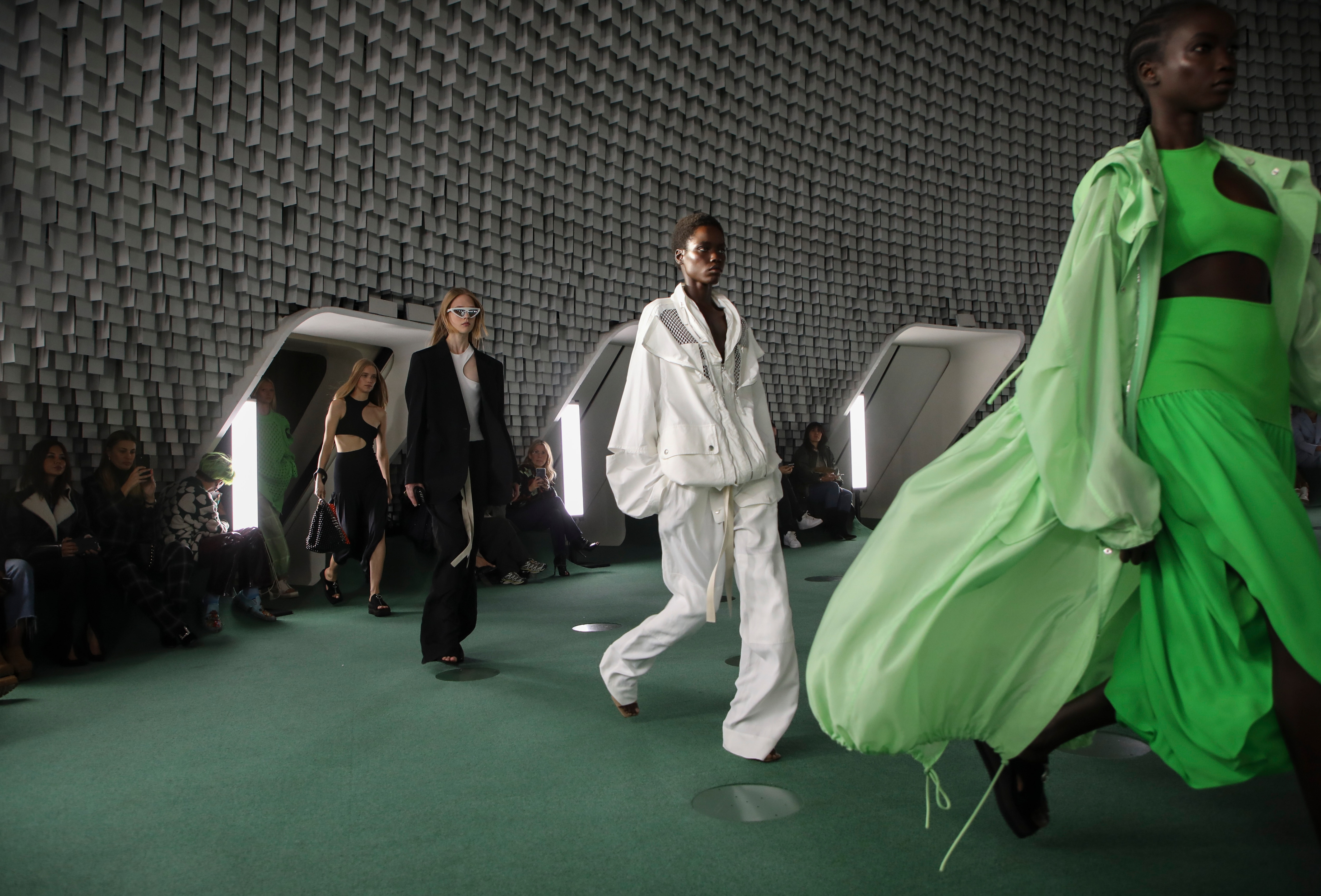 Models wear creations for the Stella McCartney Spring-Summer 2022 ready-to-wear fashion show(Vianney Le Caer/Invision/AP)