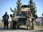 Taliban fighters working as a police force stand guard next to a Humvee vehicle at the entrance gate of a police district in Kabul.(File Photo / AFP)