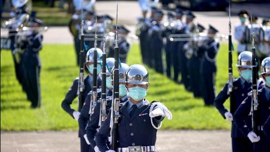 Taiwan honour guards perform during a national day rehearsal in Taipei on Tuesday. Military tension between China and Taiwan, which Beijing says is a breakaway region, has intensified in the last few days with a record number of Chinese fighter aircraft flying into the island's air defence zone. (REUTERS)