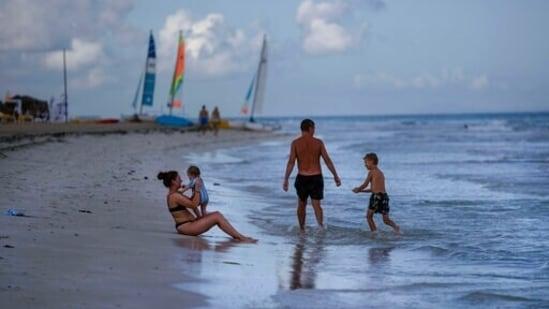 Tourists enjoy the beach at the Iberostar Selection Varadero hotel in Varadero, Cuba. Authorities in Cuba have begun to relax Covid restrictions in several cities like Havana and Varadero.(AP Photo/Ramon Espinosa)