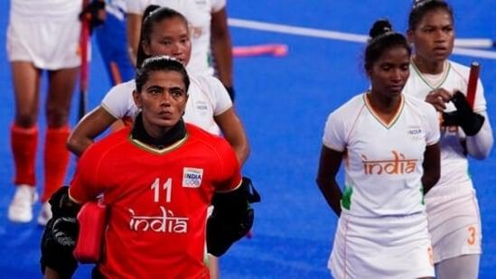 India goalkeeper Savita (11) and her teammates(AP)