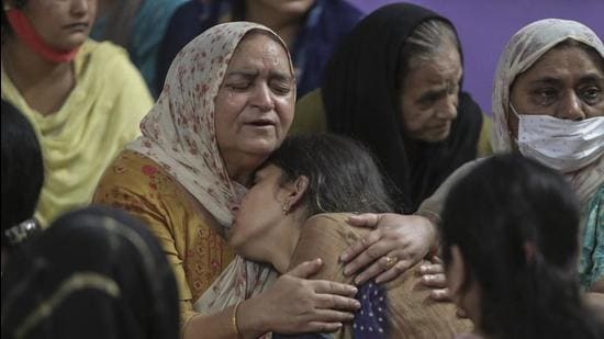 Relatives of Deepak Chand, the school teacher killed by terrorists on Thursday, mourn at their residence, in Jammu and Kashmir. School principal Satinder Kour was also killed in the terrorist attack. (AP)