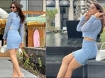Television sensation Aamna Sharif's latest pictures from Dubai, in a bold fashion and shorter hemline, serves millennial fashion inspiration as the actor looked bold and edgy in a pastel blue crop top and a high-waist mini skirt.(Instagram/aamnasharifofficial)