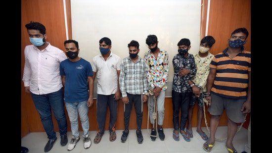 The eight suspects in the police custody in Noida on Friday. (Sunil Ghosh/HT)