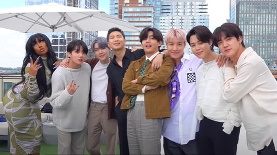 BTS members with Megan Thee Stallion.