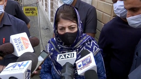 PDP Chief Mehbooba Mufti speaks to media after visiting the residence of Makhan Lal Bindroo who was killed by militants, in Srinagar.(ANI)