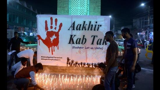 Kashmiri Pandits take part in a candle light protest against the killing of three persons, October 6, 2021 (PTI)