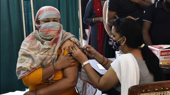 This month, the health department has administered over 100,000 jabs as second-dose Covid-19 vaccinations in the district. A health worker inoculates a beneficiary at the Sector 31 polyclinic, (Vipin Kumar /HT PHOTO)