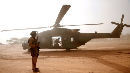 A French soldier stands guards in front of an NH90 Caiman military helicopter during Operation Barkhane in Mali.(File Photo / REUTERS)