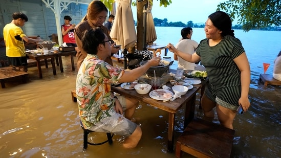 Flood dining at a riverside restaurant becomes a hit among tourists in Thailand(AP)