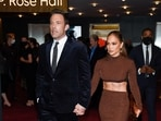 Actors Ben Affleck and Jennifer Lopez walked hand in hand as they arrived for the premiere of The Last Duel at Rose Theater at Jazz in New York on Saturday. (Photo by Evan Agostini/Invision/AP)(Evan Agostini/Invision/AP)