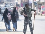 A security personnel stands guard during a surprise checking in Srinagar, Saturday, Oct. 9, 2021. Srinagar city has been put on a high alert following the recent several civilian killings. (PTI Photo/S. Irfan)(PTI)