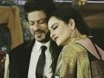 Shah Rukh Khan and Rekha at an event.