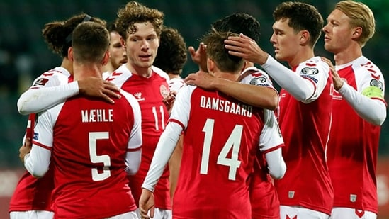 Denmark's defender Joakim Maehle celebrates with teammates after scoring the team's fourth goal.(Getty)