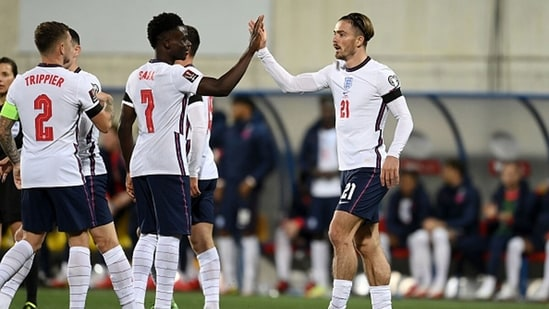 Jack Grealish of England celebrates with Bukayo Saka after scoring their team's fifth goal.(Getty)